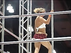 Women in bikinis pole dance