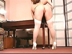Busty brunette secretary rubs her wet pink clit