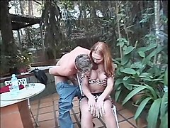 tranny on her knees gives massive blowjob to guys big cock