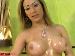 feminine tranny in lingerie oils up her bigtits and cute ass