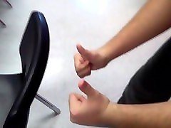 young teen fists in classroom (with both hands)