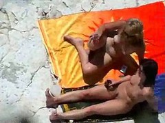 Sunbathing Beach Sluts Have Some Teen Group Sex Fun