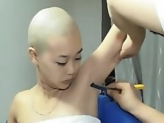 girl head and armpits shaved by barber by straight razor in his saloon.....