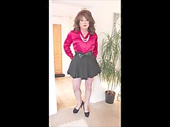 red satin blouse and black pleated mini skirt