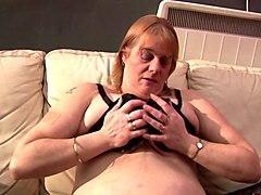 fat granny with big breasts gives herself a great satisfaction
