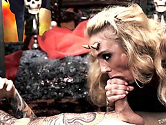 tattooed guy with horns gives the kinky blonde a nice pussy ramming