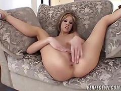 Blonde Teen Sits On The Couch And Uses A Dildo On Her Pussy
