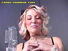 Busty blonde Candy handcuffs her cuckold and tortures him